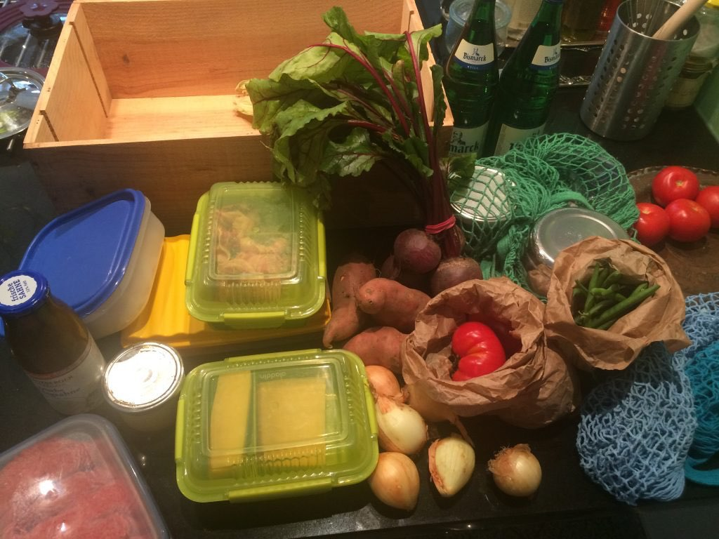 "A typical ""low waste"" grocery haul with food, loose, or stored in our own tupperware containers, reused paper bags, or sold in glass bottles."